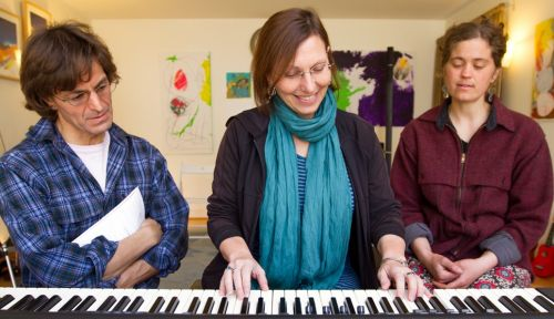 Nicholas Mortimer, Certified Simply Music teacher, during a group class with students Deborah Lisman and Heidi Wilson .