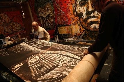 ​Hector Duarte and Edgar Lopez. Two of the artists who were leadingThe monumental woodcut project. Photo courtesy of Alexy Lanza.