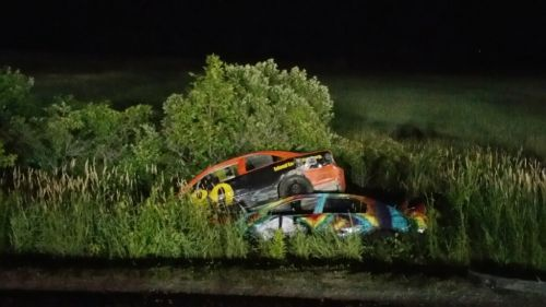 The cars of Hunter Murray (#80) and Stephen Williams (#15) took an off-track excursion during the Enduro Series race at Devil's Bowl Speedway and wound up in this precarious situation on the bank of a running brook next to the race track.  (Mike Bruno photo)