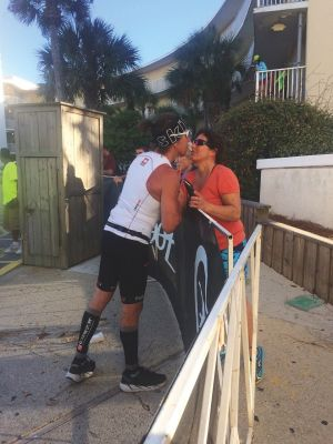 Steve DePalma kisses his wife after completing the Ironman on a replacement hip.