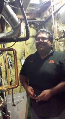 Our Technician working at Central AC unit In Colorado Springs