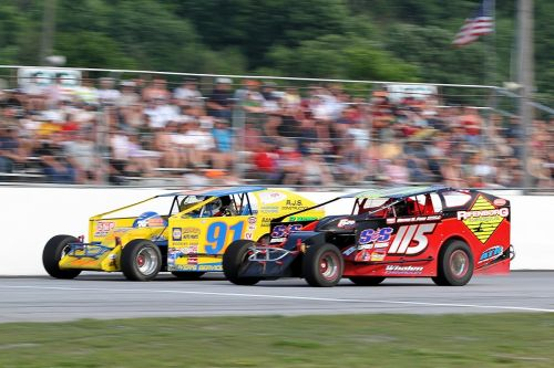 Living legend Kenny Tremont, Jr. (#115), shown here at Devil's Bowl Speedway in July with rookie front-runner Andy Smith (#91), is among as many as 30 drivers expected to tackle the 100-lap Bond Auto Parts Modified event at the Vermont 200 Weekend.  (MemorEvents photo)